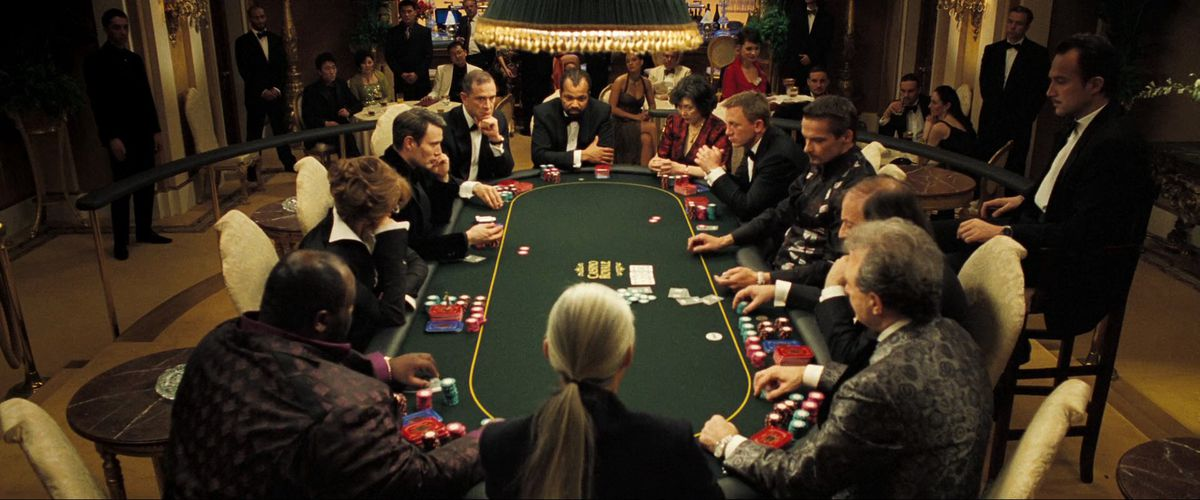 James Bond and his fellow players sit at the poker table in Casino Royale