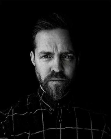 A profile picture of Luke Preece in black-and-white