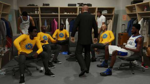 five players, four of them in warmups, sit at their lockers in NBA 2K21