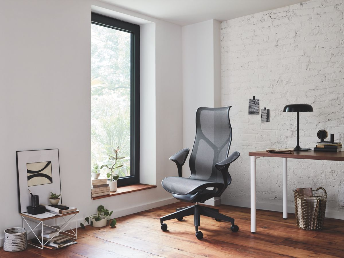 The Herman Miller High Back Cosm chair in front of a window with plants on the sill