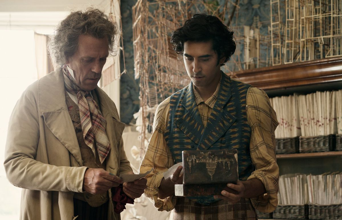 The Personal History of David Copperfield: Hugh Laurie and Dev Patel look in an old box