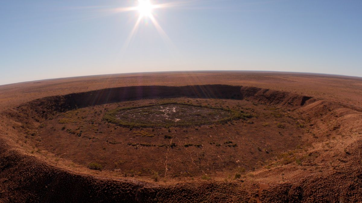 A giant crater in the red earth of Australia from Fireball documentary
