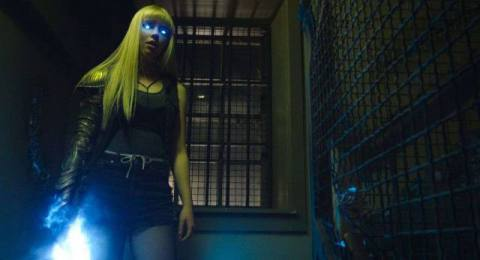 Anya Taylor-Joy in New Mutants with glowing eyes and sword