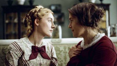 Saoirse Ronan and Kate Winslet look deep into each others' eyes in Ammonite