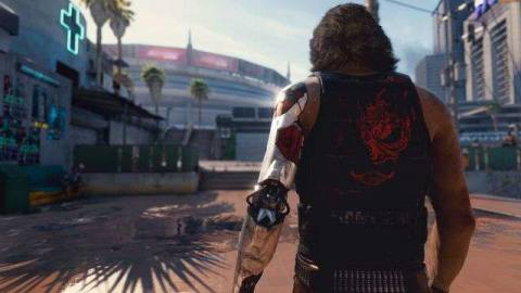 the character Johnny Silverhand with his back to the viewer, approaching a church in Cyberpunk 2077's Night City