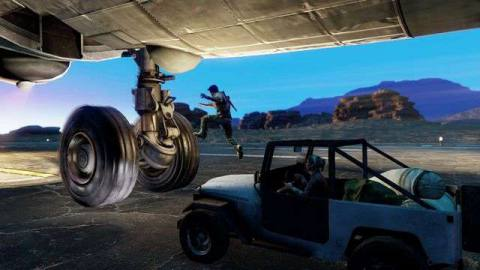 Nathan jumps from a car to a plane wheel in Uncharted: The Nathan Drake Collection's remaster of Uncharted 3: Drake's Deception