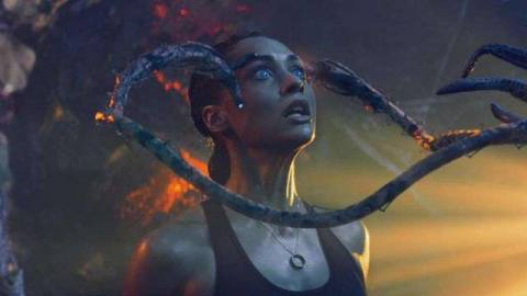 Lindsey Morgan, with glowing eyes, gets a little tentacle probe to the face in Skylines
