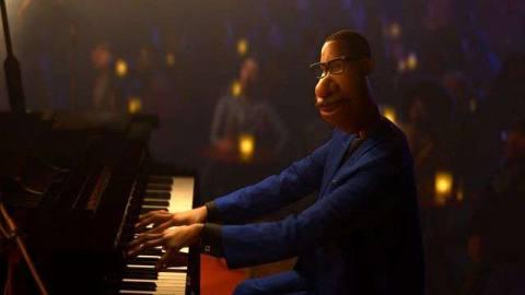 Soul protagonist Joe Gardner plays piano in a darkened room