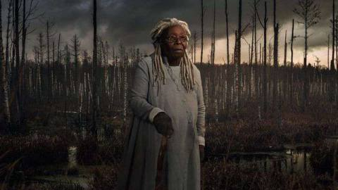 Whoopi Goldberg as Mother Abigailin a burnt up forest in The Stand