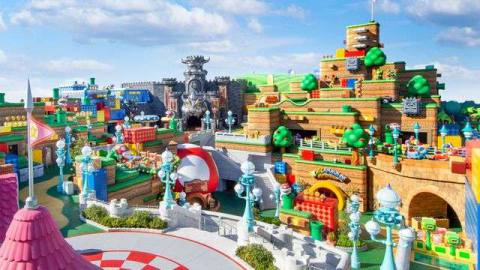 a panoramic view of super nintendo world including peach's castle