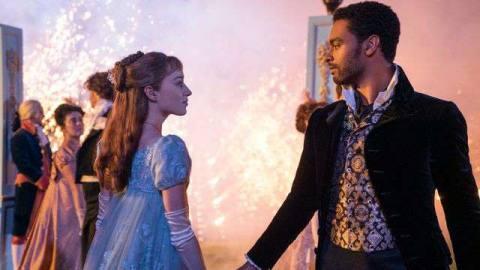 a lady in regency wear about to dance with a smokin' hot gentleman in Bridgerton