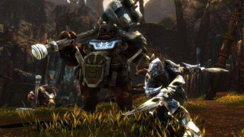 A player character swings a large sword at an armored giant.