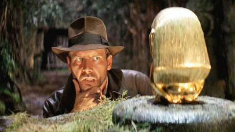 Indiana Jones contemplates the idol from Raiders of the Lost Ark