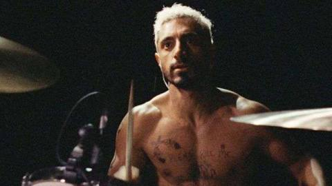 Riz Ahmed shirtless and drumming in Sound of Metal