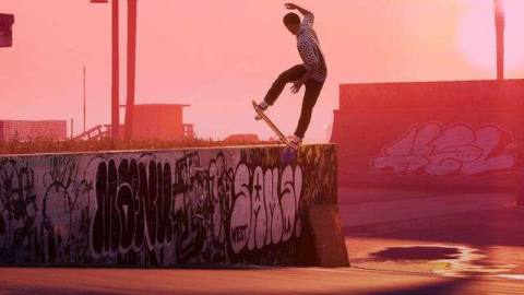 Skateboarder grinding the top of a graffiti covered concrete wall