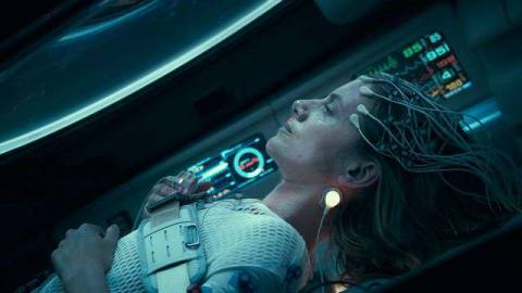 Mélanie Laurent lying back in her cryo-pod, with electrical leads attached to her head, in Oxygen