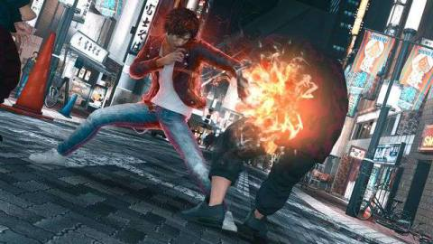 Takayumi Yagami punches an enemy on the streets of Kamuro in a screenshot from Sega's Judgment