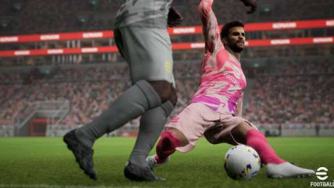 Gerard Pique of Barcelona makes a slide tackle in eFootball; his opponent is seen only from the knees down