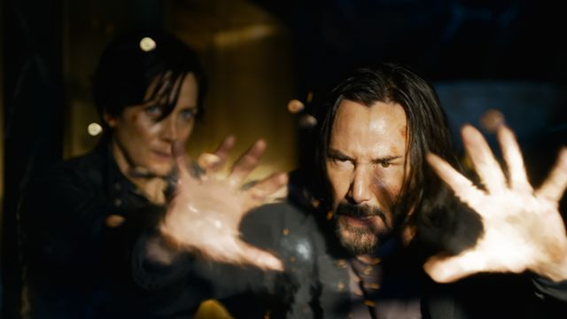 Neo uses his magic hands to protect Trinity in The Matrix Resurrections