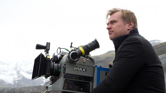 christopher nolan on the set of the dark knight rises, using an IMAX camera