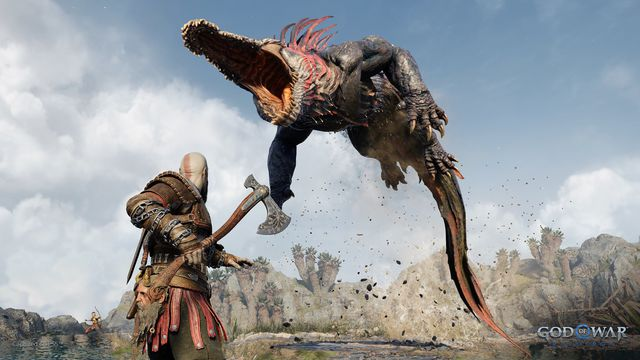 a creature that looks like an alligator attacking kratos from the air