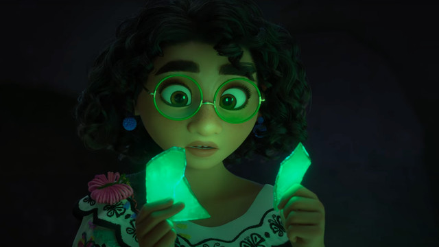 a girl with glasses puts together two glowing pieces