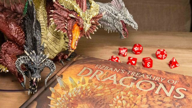 a massive five-headed dragon stands over a Dungeons & Dragons book.
