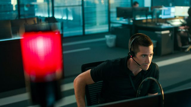 Jake Gyllenhaal mans the 911 lines under a vivid red light as demoted cop Joe Baylor in The Guilty