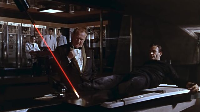 Scene from Goldfinger, the third James Bond film, in which Sean Connery is strapped to a slab of gold while a laser cutter threatens to bisect him through his crotch.