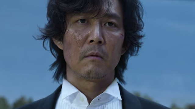 Gi-hun, looking grubby and weary in Netflix's Squid Game