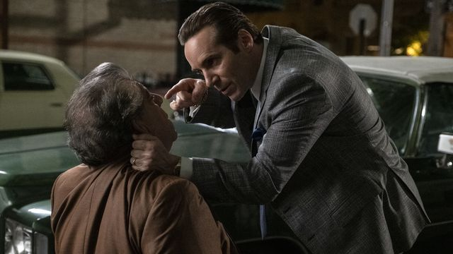 Alessandro Nivola as Dickie Moltisanti holds Joey Coco Diaz by the neck and threatens him in The Many Saints of Newark